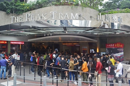 Tourists wait at the entrance of Victoria Peak Tram in Hong Kong