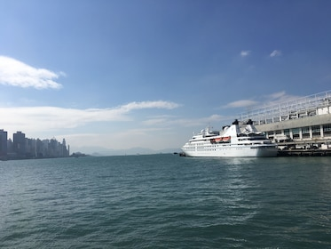 Ferry docked at terminal in Hong Kong with view of water