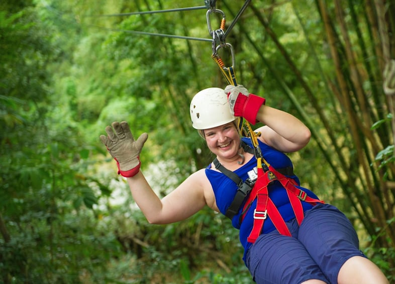 Show item 1 of 6. Woman with helmet poses on zip line in Punta Cana