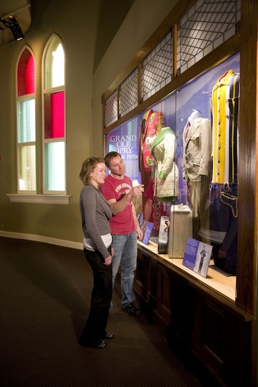 Show item 5 of 6. Costumes on display at the Ryman Auditorium in Nashville