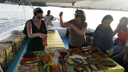 Tourists admire beaded necklaces on lunch cruise in the Nile