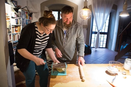 Couple on an authentic regional cooking class in Treviso with a local
