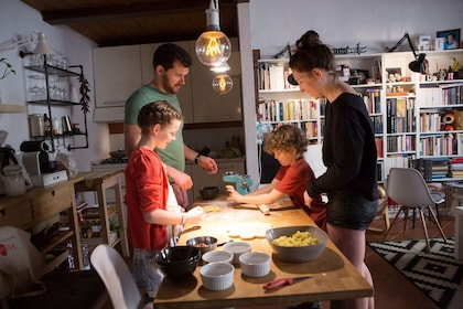 Family on an authentic regional cooking class in Treviso with a local