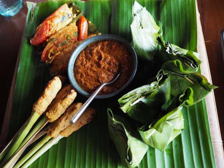 Show item 1 of 4. Balinese food on a large palm leaf