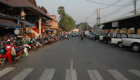 Street full of parked cars and mopeds in Mae Hong Son