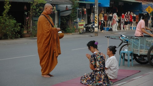 Monk offering food in Mae Hong Son