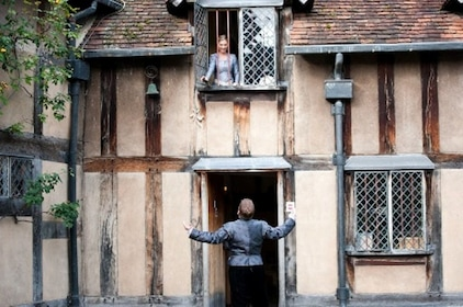 Woman looking down from an open window at Shakespeare's Stratford