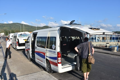 Guests loading on to a minivan in Thailand