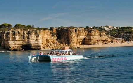 Day view of a catamaran boat cruising around Albufeira