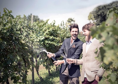 Men having some Prosecco at a vineyard in Asolo