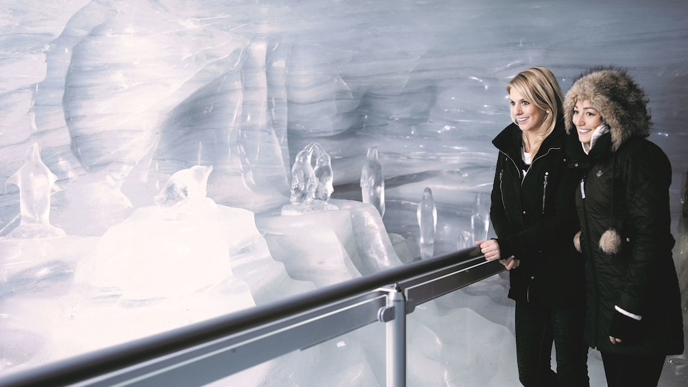 Show item 3 of 9. Two women stand in the Jungfraujoch Ice Palace