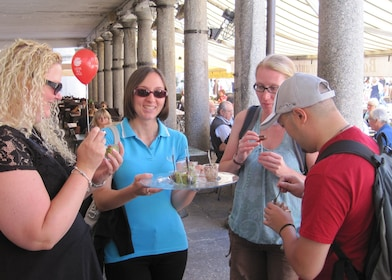 Tourists try appetizers in Lecco, Italy