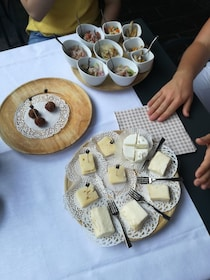 Closeup view of cheese plate and appetizers in Lecco, Italy