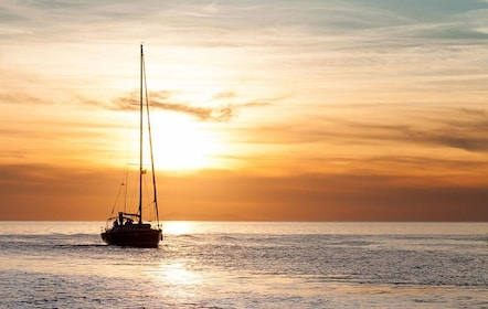 Sailboat at sunset in Mykonos, Greece