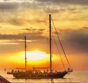 Sailboat in Mykonos during bright sunset