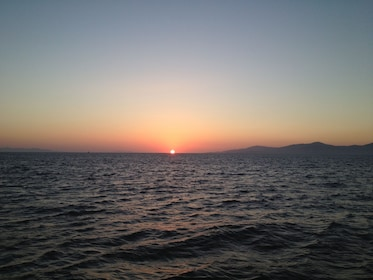 The sun sets over Mykonos, Greece
