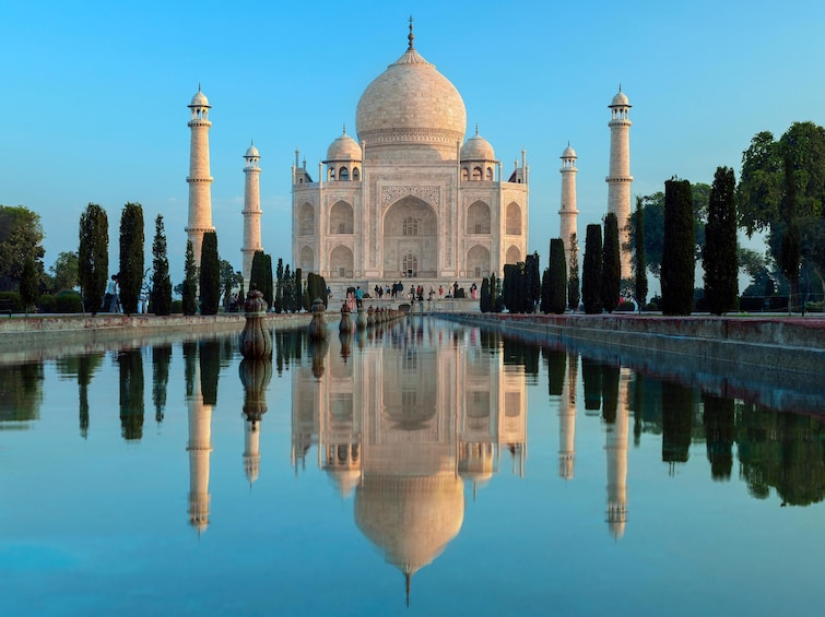Show item 1 of 2. Taj Mahal and its reflection in a pool