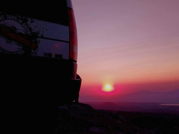Show item 5 of 6. Closeup of Land Rover tail light with Kos sunset in the background