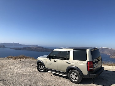 Land Rover parked at lookout point in Santorini