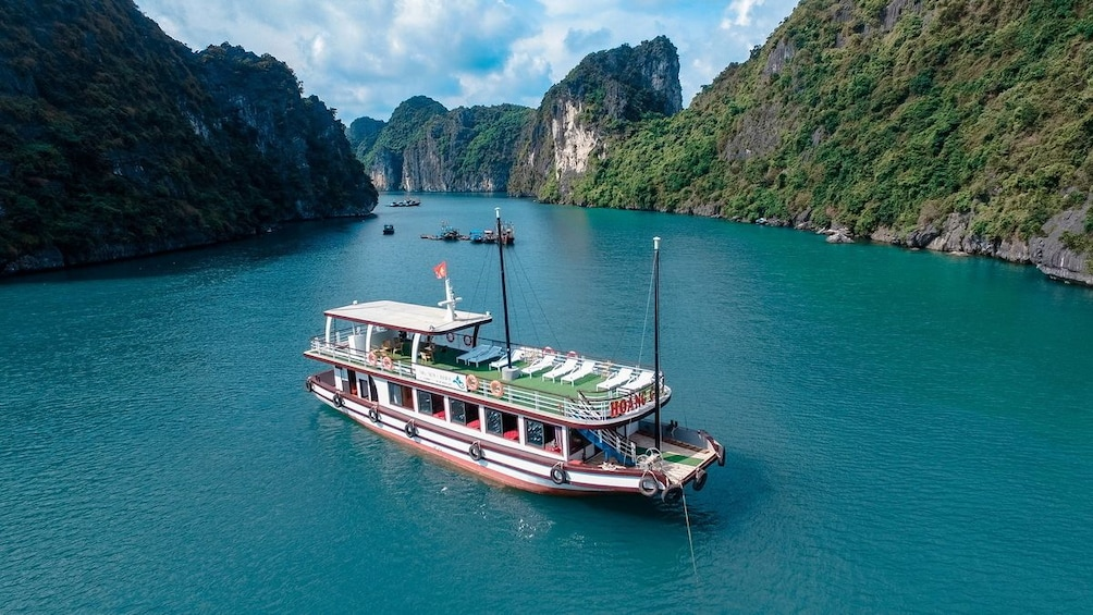 Show item 3 of 10. Aerial view of boat on Halong Bay on a sunny day