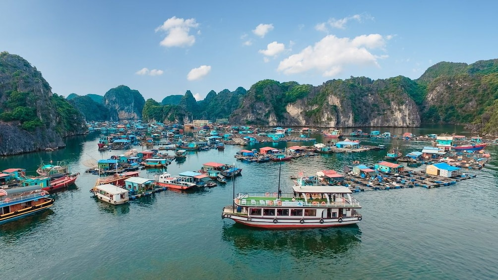 Show item 2 of 10. Aerial view of Halong Bay crowded with boats