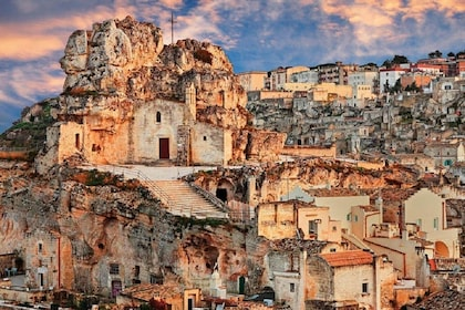 Buildings on the coast of Matera at sunset