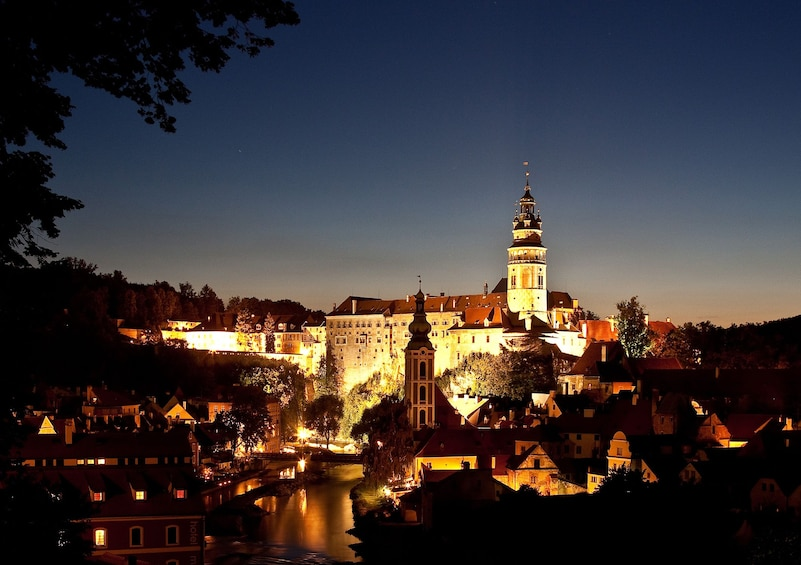 Show item 1 of 10. Cesky Krumlov Castle and surrounding area lit up at night