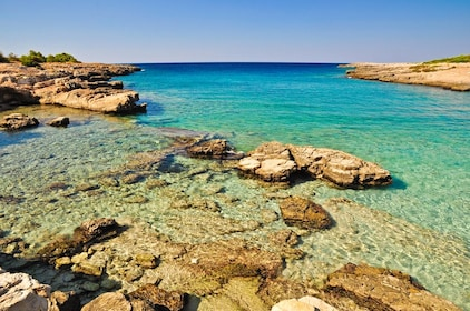 Clear blue water and rocks on the Salento Coast