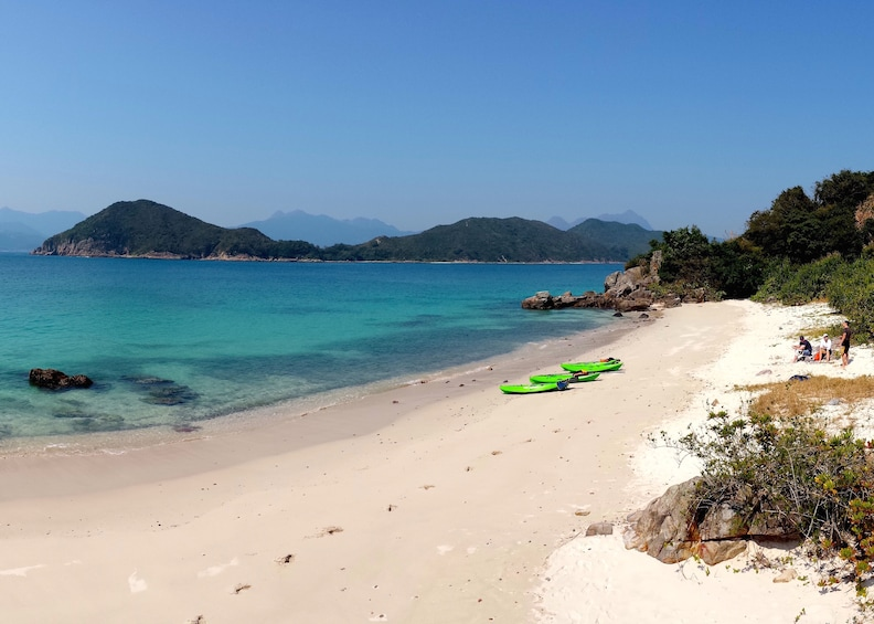 Show item 2 of 6. Day view of green kayaks on the beach at Hong Kong Geopark