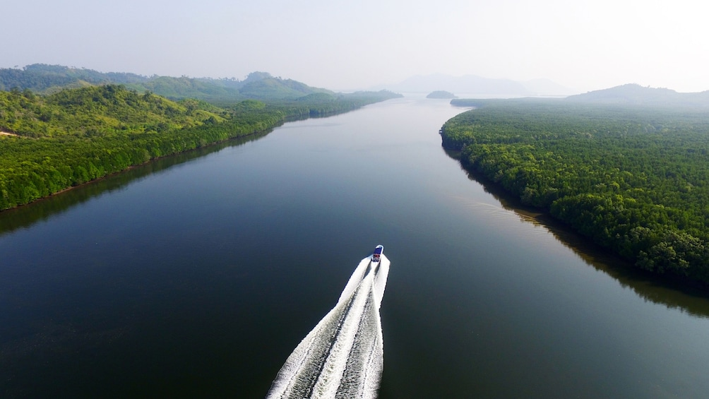 Show item 2 of 9. Aerial view of a speedboat cruising in the Kam Islands