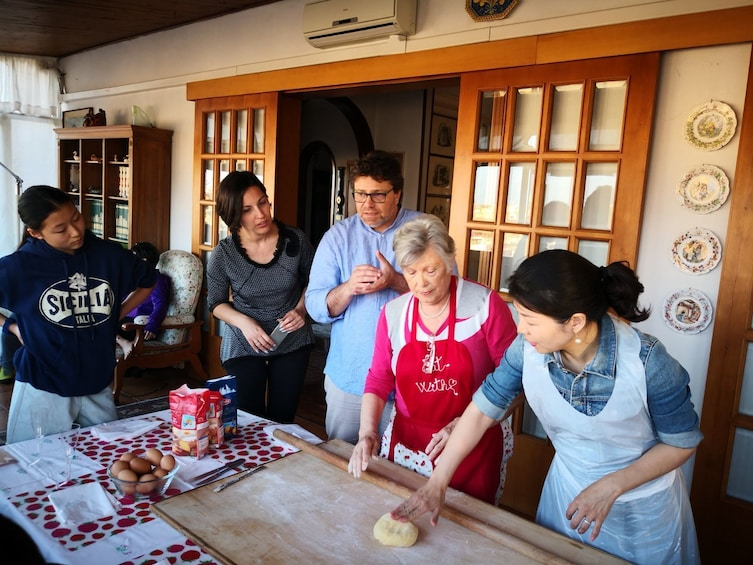 Show item 1 of 5. Instructor demonstrates how to roll out pasta dough in Cortona, Italy