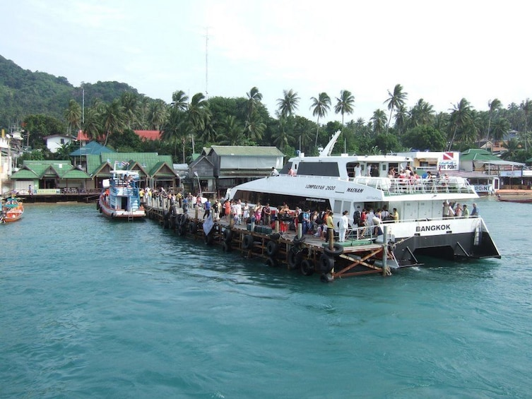Show item 7 of 7. Lomprayah boat docked at pier in Thailand