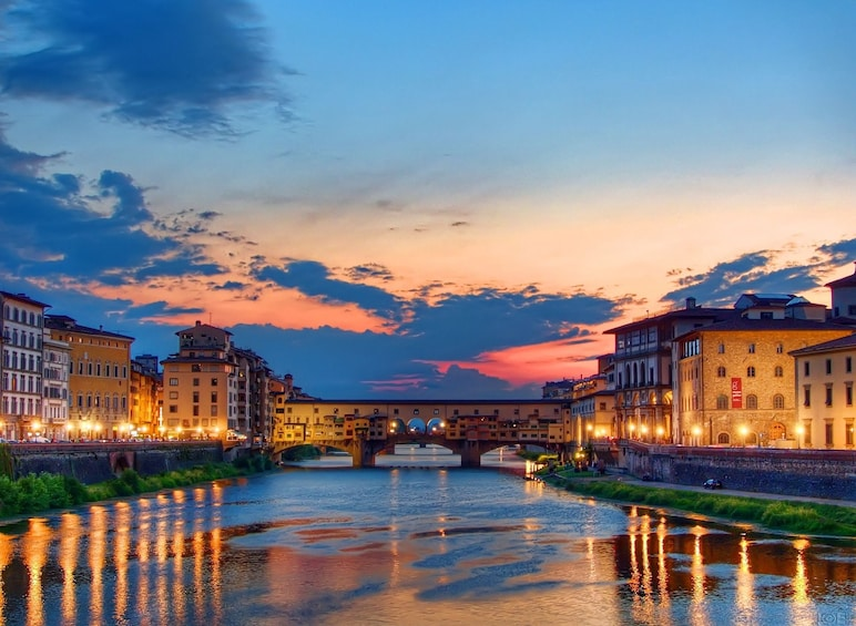 Show item 3 of 10. Sunset reflects on the River Arno