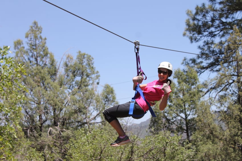 Show item 3 of 5. Woman poses while zip lining in Durango, Colorado