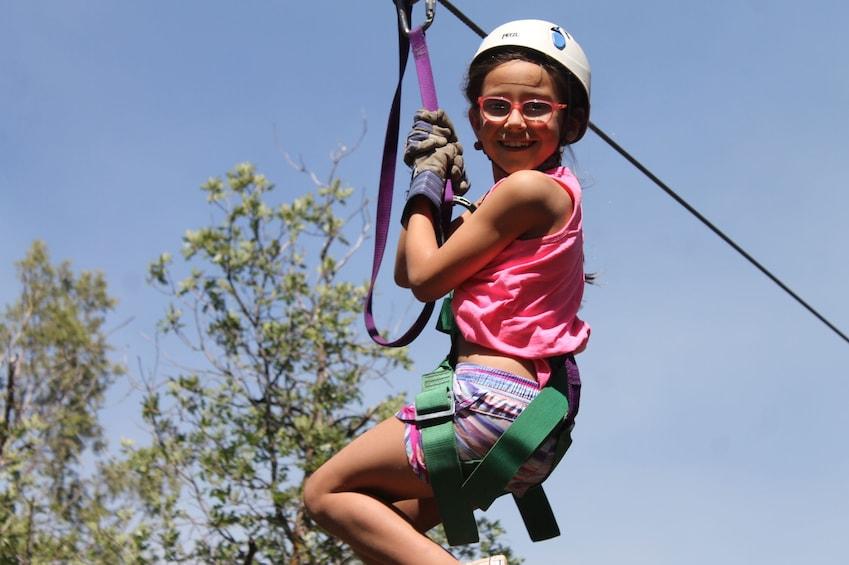 Show item 5 of 5. Little girl zip lines in Durango, Colorado