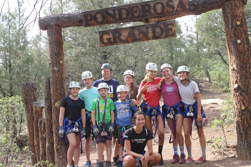 Show item 2 of 5. Group pose before zip lining in Durango, Colorado