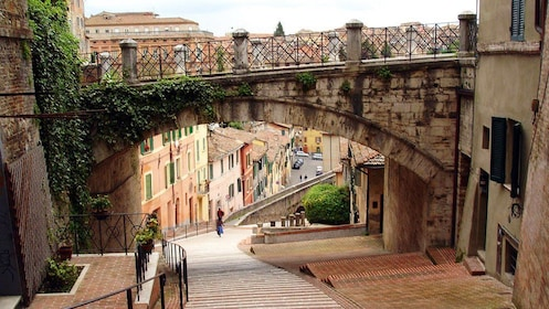 Steep hill with bridge over it in Perugia, Italy