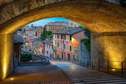 Lit stone corridor in Perugia, Italy