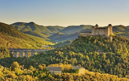 The sun shines on mountains and forests of Spoleto, Italy