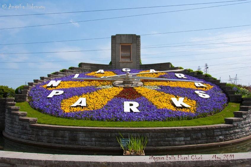 "Flower clock that says ""Niagara Parks"""