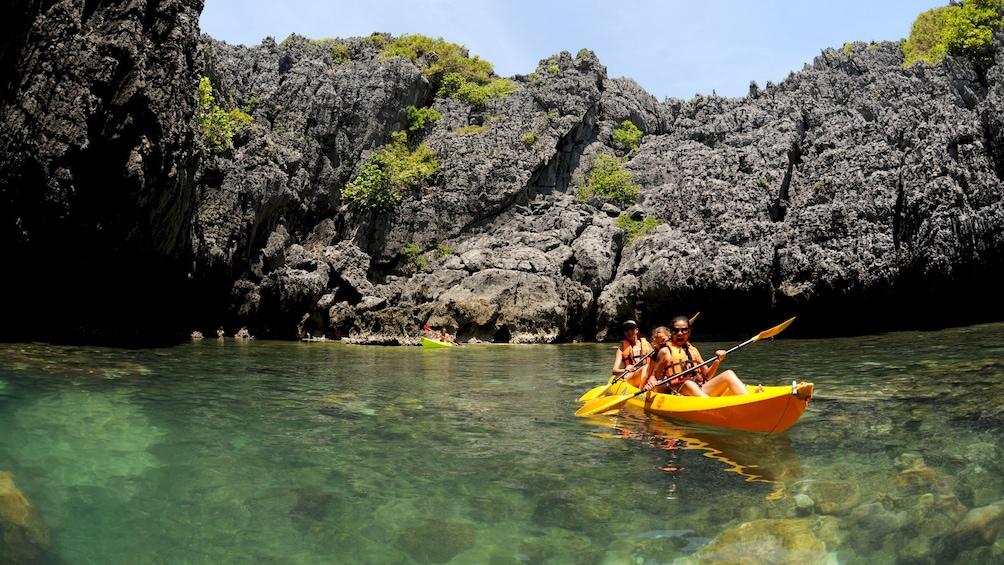 Group Sea Kayaking at Angthong National Marine Park on a sunny day
