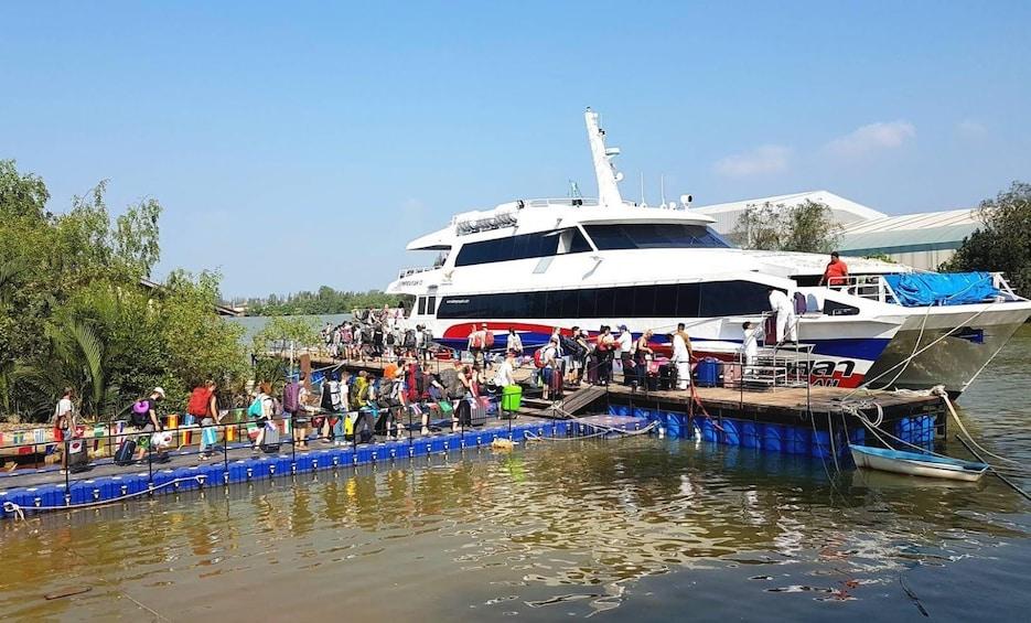 Show item 9 of 9. Guests boarding a Lomprayah Catamaran in Thailand
