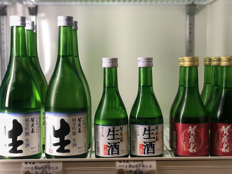 Show item 3 of 10. Different-sized bottles of sake