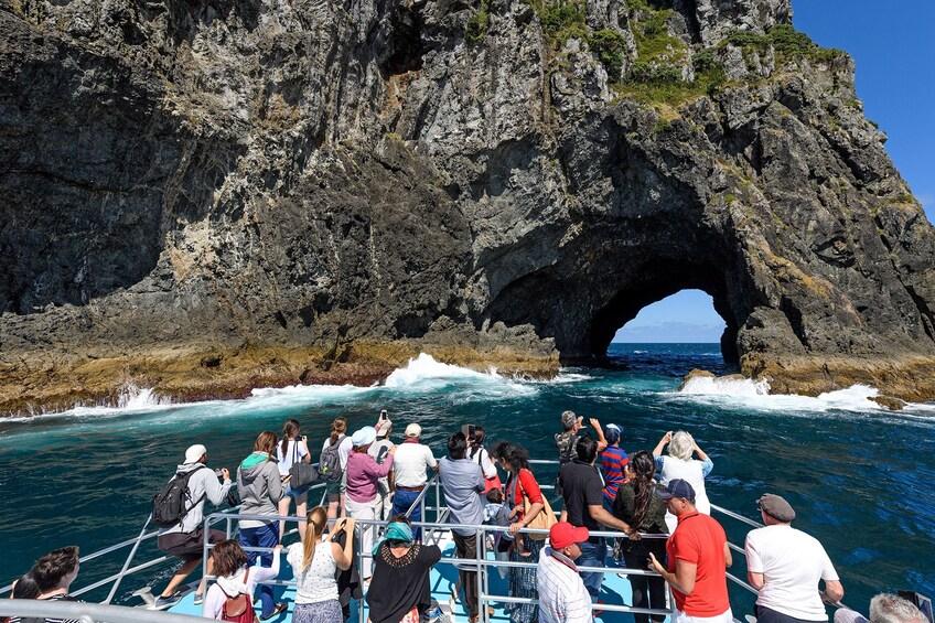 Show item 5 of 5. View from crowded cruise ship of Motukokako Island