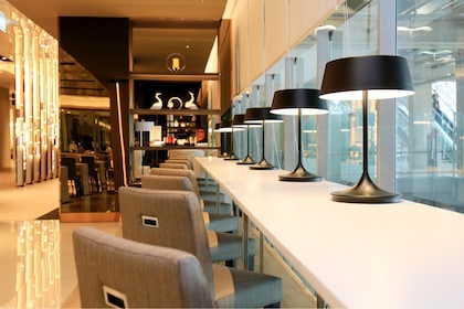 Seating area and lamps at the Miracle Lounge in Bangkok Airport