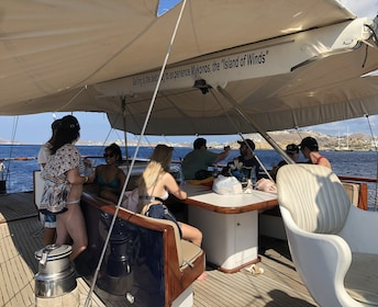 Passengers sit under shaded area on boat in Greece