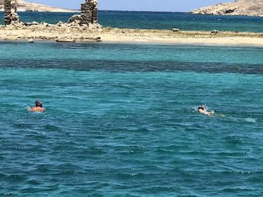 Two tourists snorkel in the waters of Rhenia, Greece