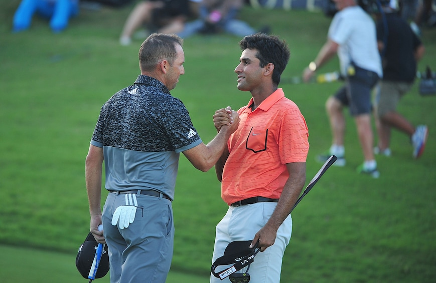 Show item 10 of 10. Himmat Rai congratulates Sergio Garcia on wining the Ho Tram Open after a series of play-offs
