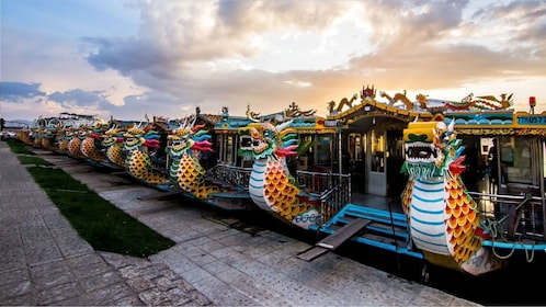 Boats with colorful dragons on the helms in Hue, Vietnam