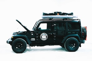 Jeep Wrangler with Rooftop Tent & Camping Gear